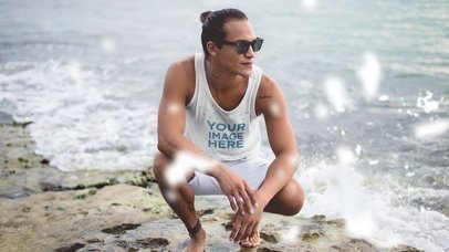 Young Surfer Guy Wearing a Tank Top And Sunglasses At a Rocky Shore Cinemagraph Mockup a13754