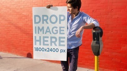 Young Man Holding a Poster While Leaning On A Parking Meter Stop Motion Mockup a13652