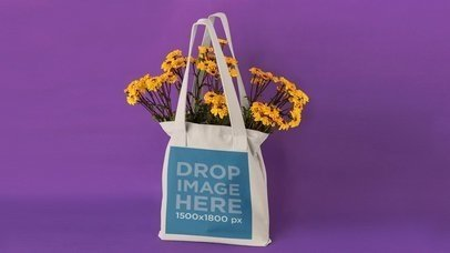 Stop Motion Mockup Of A Tote Bag On Purple While Flowers Dissapear a13665