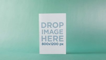Book Standing Against Light Green Surface And Background Turning Back And Forth To Be In Perspective Stop Motion Mockup a13675