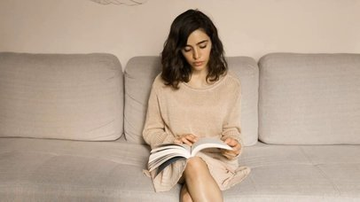 Beautiful White Girl Sitting Down Reading A Book Video Mockup a13924