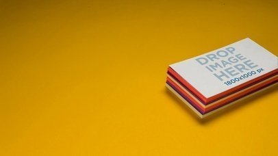Video Mockup Of A Pile Of Business Cards Lying Over A Yellow Background a13965