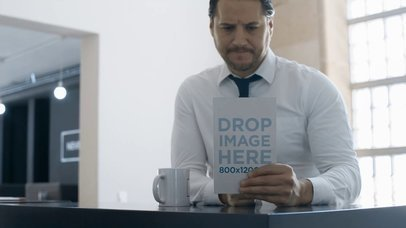 Business Man Having a Coffee While Taking a Look at a Book Mockup Video a14152