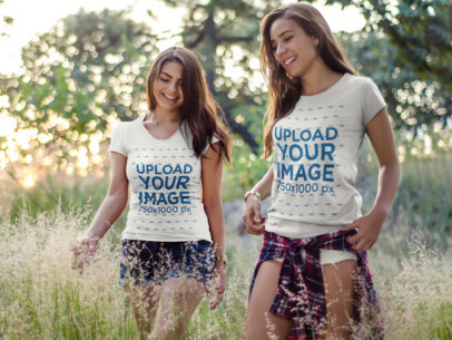 Two Girls Wearing Different T-Shirts Mockup Having Fun While Walking Outdoors a15315