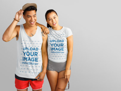 Two Friends Wearing a Tank Top and a Tshirt With Different Designs Against a Gray Background a15448