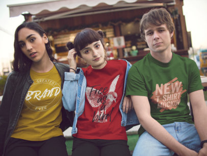 Three Young Friends Wearing Different T-Shirts Mockup Hanging Out Outdoors a15569