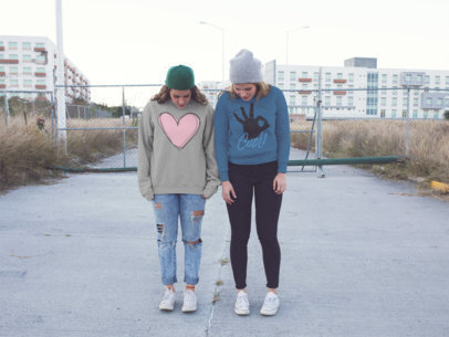 Two Girls With Their Head Down Wearing Different Crewneck Sweatshirts Mockup a15710