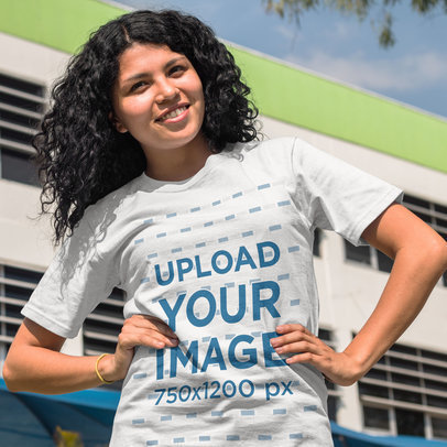 Girl with Curly Hair Wearing a Round Neck Tshirt Template While Smiling a15655