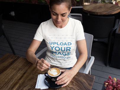 Middle Aged Woman Wearing a T-Shirt Mockup While at a Cafe a15865