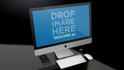 Black Room with a Black iPhone Earpods and an iMac Mockup Video a15826
