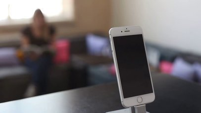 App Demo Video of an iPhone Standing on a Room Near Cup of Hot Coffee a15845