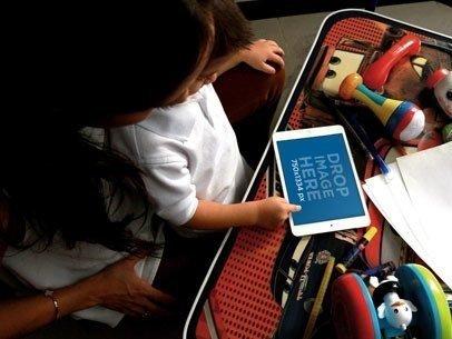 Boy Playing White iPad Mini