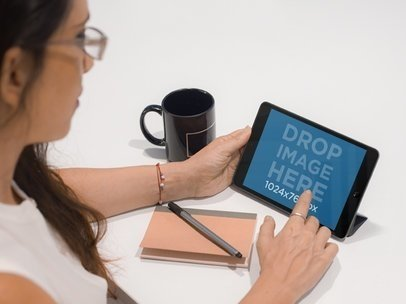 Tablet Mockup Featuring a Businesswoman Working on an iPad a5465