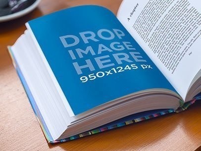 Mockup Featuring a Book Lying Open on Top of a Wooden Table a5900