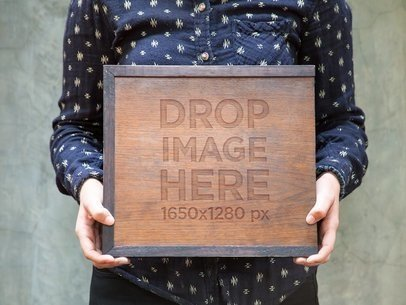 Branding Mockup Featuring a Man Holding a Wooden Box a6998