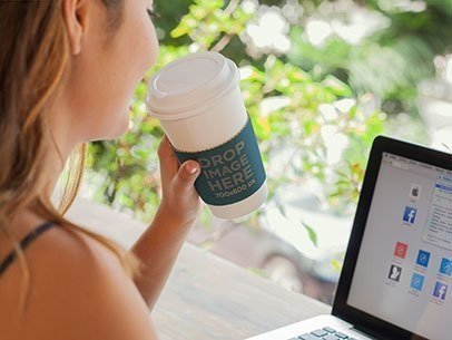 Takeaway Coffee Cup Mockup of a Woman Working on a Macbook a6988