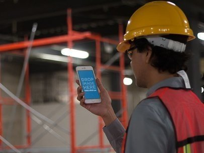 iPhone 6 Plus Held by a Civil Engineer on the Job a12581