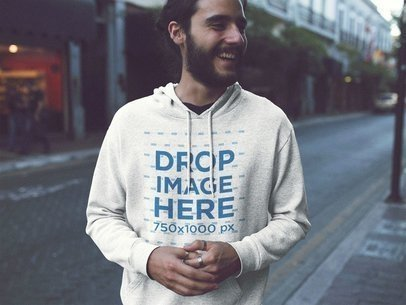 Pullover Hoodie Mockup of a Handosme Young Man with Long Hair Laughing in the City a12602