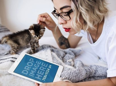 Hipster Girl Lying in her Bed with a Kitten and White iPad Mini Mockup a12793