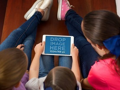iPad Mini in Landscape Position Mockup of Three Friends Using an iPad at Home a12993