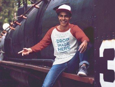 Raglan T-Shirt Mockup of a Young Man Laughing on a Train Wagon a12491
