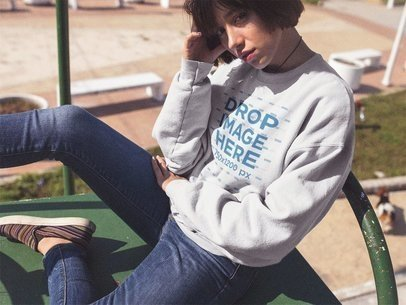 Urban Style Girl with Short Hair Wearing a Crewneck Mockup at a Park a12655