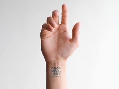 Mockup of a Hand Showing an Inner Wrist Tattoo Against a White Background a14510