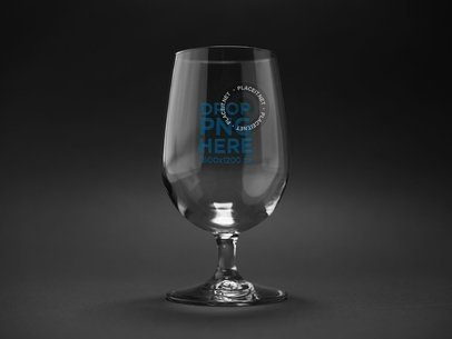 Snifter Glass Against a Black Background Mockup a14660