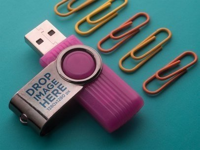 Purple USB Flash Drive Template Lying on a Turquoise Surface Near Clamps a6545
