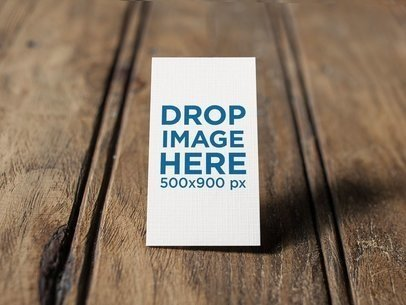 Vertical Business Card Mockup Standing on a Wooden Surface a14993