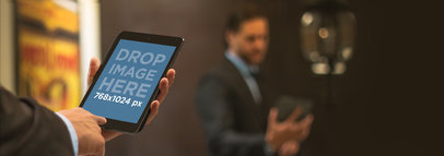 Mockup of a Corporate Man Using a Black iPad Mini