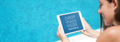 Tablet Mockup of a Young Woman Lounging by the Pool Using an iPad a4810