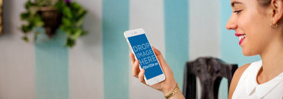 Woman Using iPhone 6 in Front of a Striped Painted Wall Mockup a4906